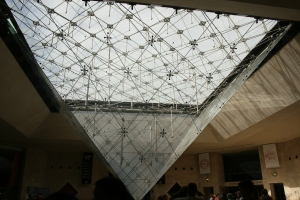 View of the glass pyramid from underground in Carrousel du Louvre